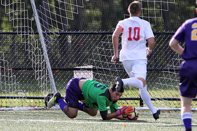Nick Forlano (lower) dives for the ball as Point Pleasant Beach's Ki Costa 9right) attempts the shot on goal as St. Rose High School hosted Point Pleasant Beach High School in a boys varsity soccer game held in Tinton Falls on Wednesday October 3, 2018 (MARK R. SULLIVAN /THE COAST STAR)