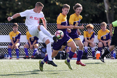 Ki Costa (left) from Point Pleasant Beach gets his foot on the ball as St. Rose players Evan Walters and Luke Fahy pace me as St. Rose High School hosted Point Pleasant Beach High School in a boys varsity soccer game held in Tinton Falls on Wednesday October 3, 2018 (MARK R. SULLIVAN /THE COAST STAR)