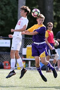Robert D'Agastaro (left) from Point Pleasant Beach battles with Matt Kirkpatrick from St Rose for a head ball as St. Rose High School hosted Point Pleasant Beach High School in a boys varsity soccer game held in Tinton Falls on Wednesday October 3, 2018 (MARK R. SULLIVAN /THE COAST STAR)