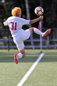 Justin Mazzatta from Point Pleasant Beach leaps in the air to try and keep the ball in bounds as St. Rose High School hosted Point Pleasant Beach High School in a boys varsity soccer game held in Tinton Falls on Wednesday October 3, 2018 (MARK R. SULLIVAN /THE COAST STAR)