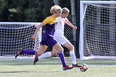 Christian Bodine (left) from St. Rose battles with Ryan Brodeur from Point Pleasant Beach as St. Rose High School hosted Point Pleasant Beach High School in a boys varsity soccer game held in Tinton Falls on Wednesday October 3, 2018 (MARK R. SULLIVAN /THE COAST STAR)