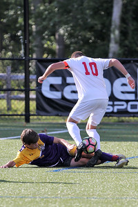 Matt Deluca (lower) from St. Rose slides to steal the ball from Point Pleasant Beach's Ki Costa as St. Rose High School hosted Point Pleasant Beach High School in a boys varsity soccer game held in Tinton Falls on Wednesday October 3, 2018 (MARK R. SULLIVAN /THE COAST STAR)