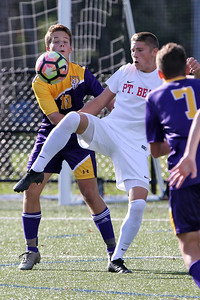 Ki Costa (center) from Point Pleasant Beach gets his foot on the ball between St. Rose defenders as St. Rose High School hosted Point Pleasant Beach High School in a boys varsity soccer game held in Tinton Falls on Wednesday October 3, 2018 (MARK R. SULLIVAN /THE COAST STAR)