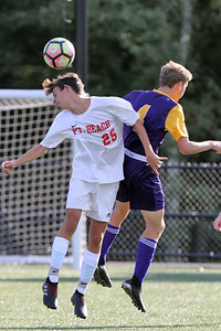Robert D'Agastaro (left) from Point Pleasant Beach gets his head on the ball ahead of St Rose's Matt Kirkpatrick as St. Rose High School hosted Point Pleasant Beach High School in a boys varsity soccer game held in Tinton Falls on Wednesday October 3, 2018 (MARK R. SULLIVAN /THE COAST STAR)