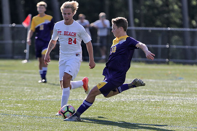 Matt School from St. Rose gets his foot on the ball ahead of Point Pleasant Beach's # 24 (left) Alex Atno as St. Rose High School hosted Point Pleasant Beach High School in a boys varsity soccer game held in Tinton Falls on Wednesday October 3, 2018 (MARK R. SULLIVAN /THE COAST STAR)