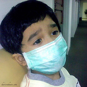 Idlan in mask  He developed fever and everyboy was worried if he had caught the virus. High temperature and the Pediatrician has started him on an antibiotic. Taken on my Nokia E71.