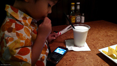 Eating nachos and drinking milkshake while watching Upin and Ipin