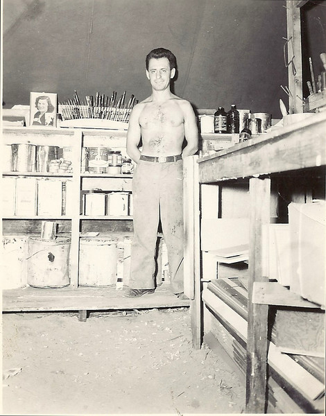 Dad in his shop in Saipan.  Note the photo of Pete's Mom on the work bench and the photo of me (Pete) in the lower right hand corner of Mom's photo.
