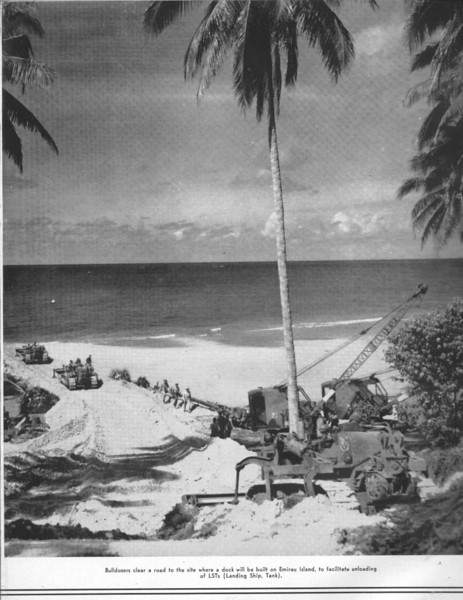 Bulldozers clear a road to the site where a dock will be built on Emirau Island, to facilitate unloading of LSTs (Landing Ship, Tank)