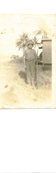 144th Seabees on Guam.  Guy with a gun.