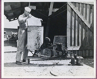 A Seabee creates a washing machine from a trash can.