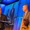 Mayor Greg Fischer presents Jay Bilas with a Louisville Slugger.