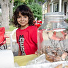 The Molinari Family, of Fitchburg, raised money for the Leukemia Lymphoma Society on Saturday afternoon with a lemonade stand on Hancock Street. Five-year-old Thiago Molinari has been battling Leukemia for three years now. Thiago stares down a jar of change donated to his cause. SENTINEL & ENTERPRISE / Ashley Green