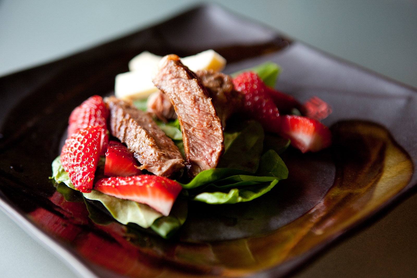 Strawberry salad with chili rubbed grilled ribeye