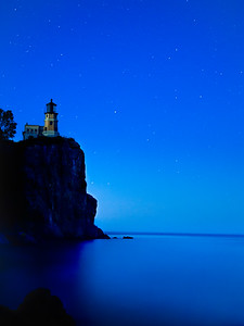 stars glow at the dark lighthouse