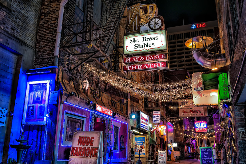 the neon glow of printers alley