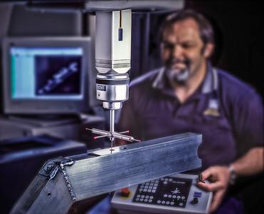 Man operating coordinate-measuring machine.