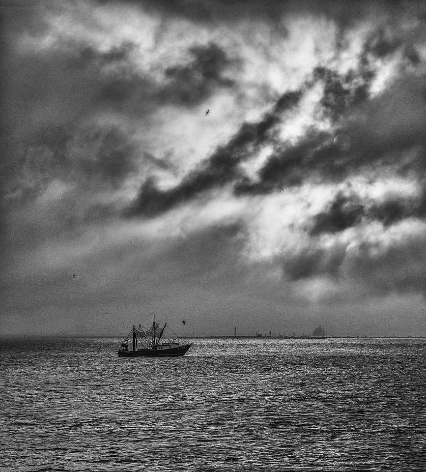 Boat and stormy clouds in Galveston Bay