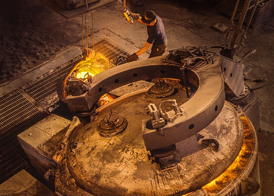 Pouring hot metal in a foundry
