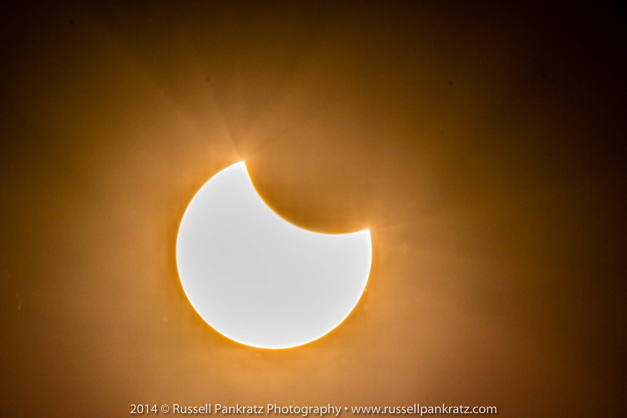 Partial solar eclipse occurring as I arrived at Hays CISD's Shelton Stadium for the James Bowie Outdoor Performing Ensemble's Marching show. There may have been a football game also.