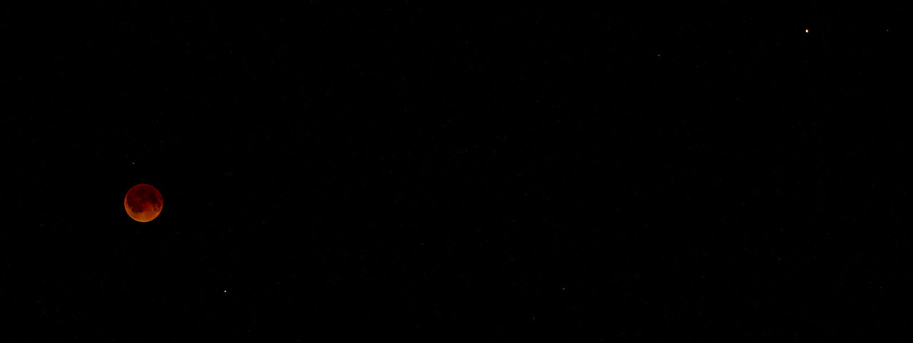 Eclipsed Moon, Spica below and right of the Moon, and Mars at upper right.