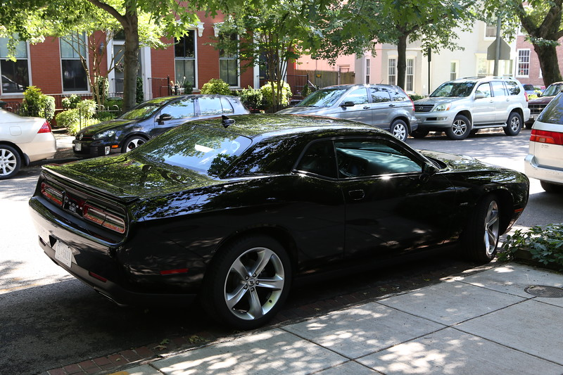 2017 Dodge Challenger R/T Coupe with 5.7 L Hemi & 6-speed stick in front of house.