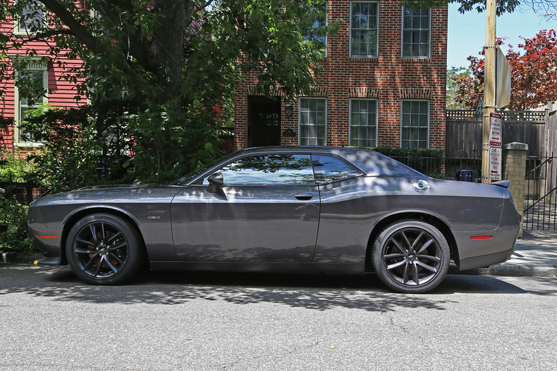 2019 Dodge Challenger R/T Coupe with 5.7 L Hemi & 6-speed stick in front of house.