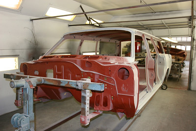 First stage of reassembly - the body has been cleaned and is being primed with two differing coats (red and grey).