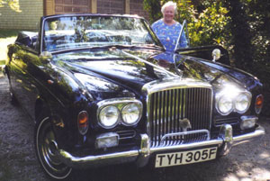 Mom Mary Otis standing next to her 1968 Bentley T Drophead Coupe at Meadowneck, Cape Cod, about 1990.