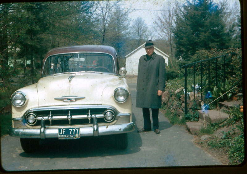 Grandpa F. N. Otis standing by his 1953 Chevy Wagon, Bloomfield CT, mid 1960s.