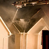 ...more roofing would fly.  They seemed to be trying to punch a hole in the roof to get at the fire...