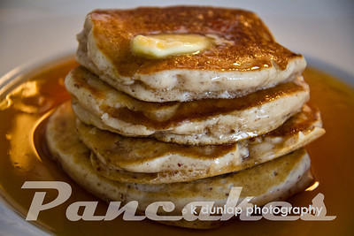 "03.13.12 = Golden Goodness  For some unknown reason, I can make a mean stack of pancakes.  I'm not sure why really, it's just one of those foods that turns out for me every single time unlike bacon.  I've gotten a little cocky over the years with my pancake perfection by adding my own special touches to the batter.  These are some of my favorites, I've added some almond meal to the batter to give them that extra little nutty flavor; (and other things that are a secret) combined with the syrup and butter, yum.  I've tried all sorts of things in my pancakes.  Once I grated some fresh ginger and combined that with some apple butter and a sprinkle of powder sugar; Hello!  I felt like a gourmet chef.  It's fun to try new things.  To me that's what cooking is all about; adding your own special touch to something and making it yours.  Fabulous or flop, at least its fun to try.   ""One of the very nicest things about life is the way we must regularly stop whatever it is we are doing and devote our attention to eating.""  Luciano Pavarotti"