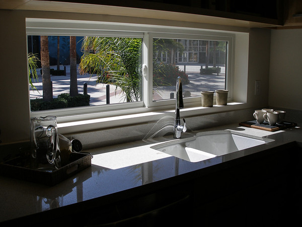 Kitchen sink with large window.