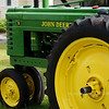I saw this old John Deere tractor (photos 1-9) one morning on the way back to work in someone's front yard. I've tried to find something on Google and so far the only guess I have is that it's a 1940's something John Deere Model B. Wish it could talk, I'll bet it could tell a lot of stories of simpler days long gone by (unless it's a horse-drawn plow!)...