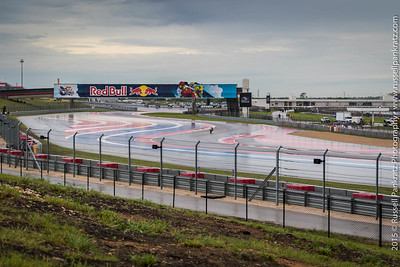 My first shooting location: inside Turn 6, looking at the racers coming at me. I can see under the Red Bull pedestrian bridge all the way to turn 2 which is more than 600 yards away. Most images are of the action on Turns 4 & 5, which is where this single cyclist is located in this image.