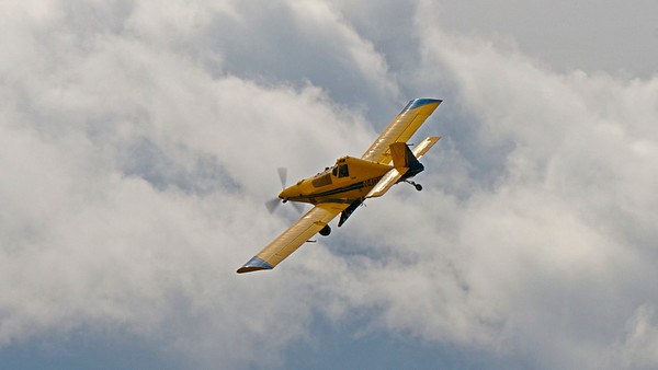 crop duster in the clouds