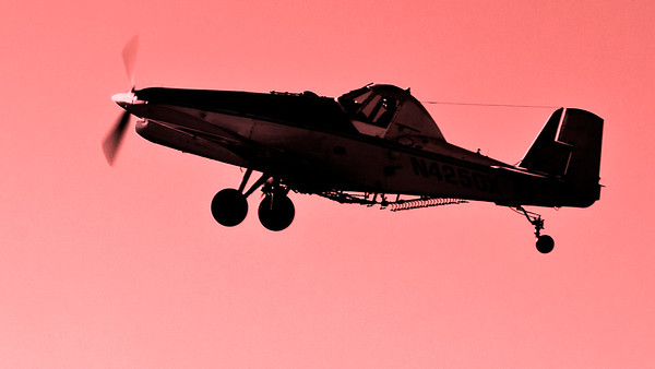 crop duster red dusk