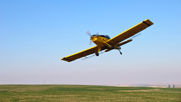 Crop duster sky and field