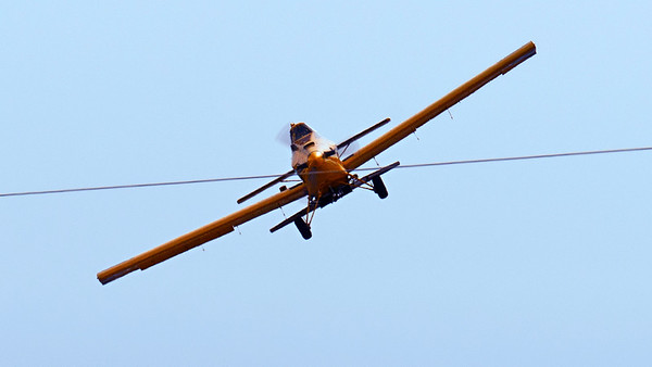 crop duster approaching power lines