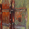 "old weathered doors...<br /> <br /> Saw these doors at my cousin's house a while back, forgotten I'd taken a pic of them. When we were growing up we lived two houses apart from each other and the house in between belonged to our neighbor (well, his parents : ), who was also about our age. These doors at the time led into the neatest model train set-up that you'd ever want to see. The trains are long gone, as is our mutual friend (moved), but the shed remains, not in the best of condition, as these doors show. My cousin bought the house, many years ago now, and currently uses the shed for storing garden ""stuff."" With all that said, these doors bring back many fond memories..."