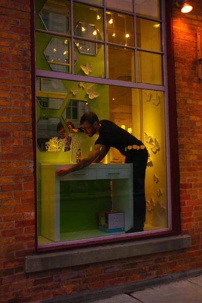 """""""Goo-Gone""""  An employee spiffs up an Ottawa window display."""
