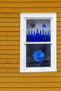 Am I blue?  Some lovely old glass graces the window of a century-old home in Colton, NY.