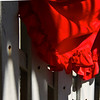 Red Drape on White Fence