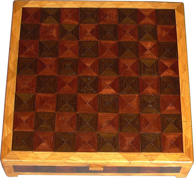 """CBox Ph-Wenge-Ash<br />    This Chess Box is about 13"""" x 13"""" and 3 5/8"""" high on the outside. Inside it is 12 1/4"""" x 12 1/4"""" x 2"""".  I made it using 612 pieces of wood cut in triangle shapes from different kinds of wood. Each square is 1 ½"""" and is made by using four triangles. This makes a design within each square and gives it a completely different look. The box is finished in its natural color with 5 or 6 coats of a clear wiping varnish, rubbed in by hand. The pieces are a bit over 3/16"""" thick, glued onto a Baltic Birch base, so they hold up much better than a thin veneer.<br />    The type of wood is listed on the bottom of the box from the center out. On this box the wood is """"Wenge"""" from West Africa, """"Purpleheart"""" from Central or South America and """"Ash heart wood"""" from Missouri. <br />     On the bottom I signed it, listed the wood, and dated it.  <br />  <br />    I lined the bottom of the box with black velveteen."""