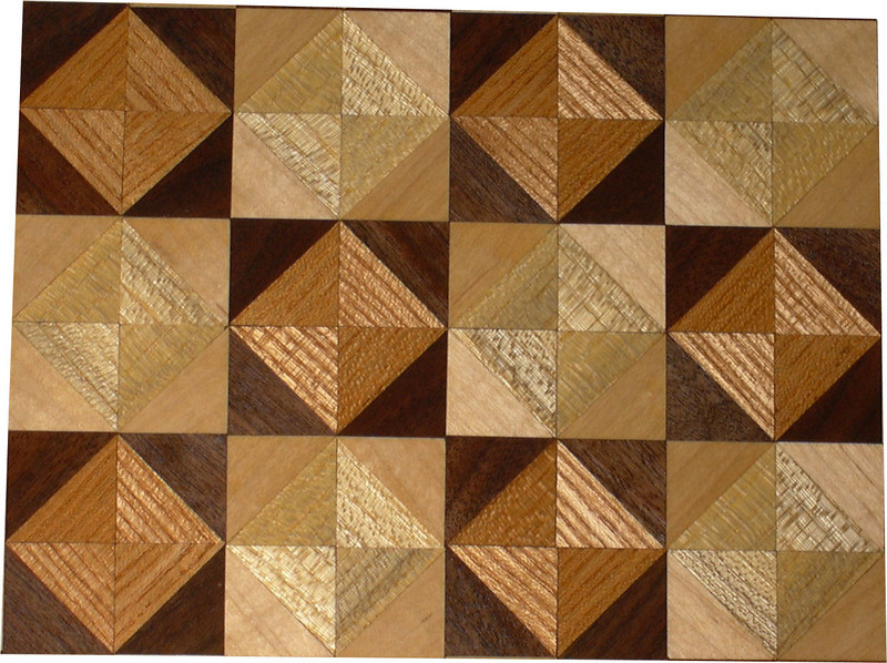 """Chess Board detail, Ky Coffee-Walnut, Hackberry-Maple<br /> Close-up<br /> This chess board is 17"""" square.  Each square is just over 2"""" and is made using 8 triangles.  Two types of wood are in each square.  Four kinds of wood are on the chess board.  The dark square has """"Ky Coffee"""" from Illinois and """"Walnut"""" from Missouri; the light square has """"Hackberry"""" and """"Maple"""" from Missouri.  There are 612 pieces in the over lay.<br />   <br />   This gives a completely different look to a chess board.  When not being used as a chess board, it is made to hang on the wall from one corner.  They make a very beautiful wall hanging."""