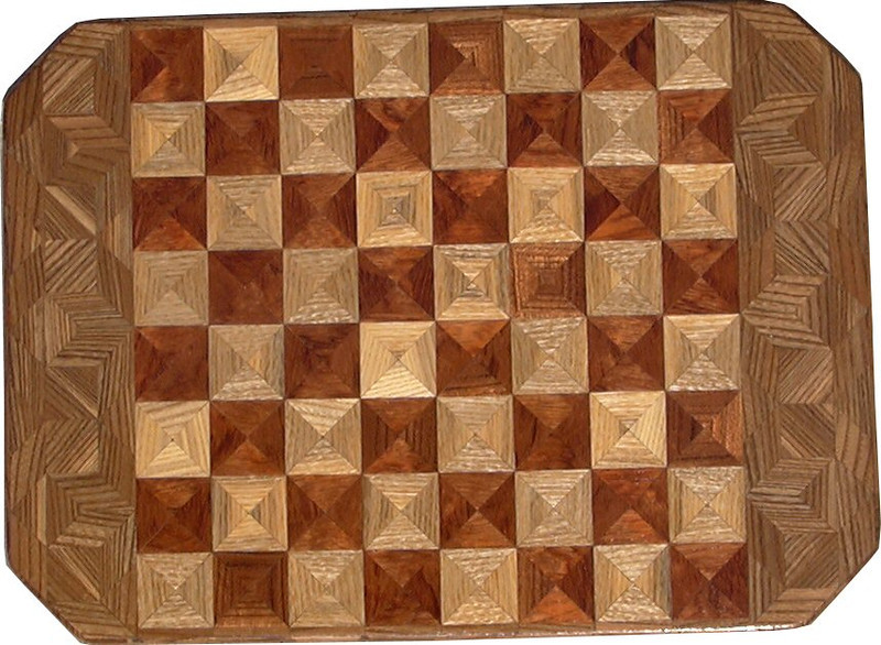 """Cbd 12X18 HB-Bub-Elm<br />   This chess board is 12"""" square, 12 ½"""" X 17 ½"""" over all.  Each square is 1 ½"""" and is made using 4 triangles.  Three kinds of wood are on the chess board.  The dark square is """"Bubinga"""" from Africa (African Rosewood); the light square is """"Hackberry"""", """"Elm"""" is around the chessboard, both from Missouri. There are 432 pieces in the over lay.<br /> <br />    On the back, I signed it, listed the wood, and dated it.  <br />   <br />   This gives a completely different look to a chess board.  When not being used as a chess board, it is made to hang on the wall.  They make a very beautiful wall hanging."""