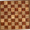 "Cbd 12X18 HB-Bub-Elm<br />   This chess board is 12"" square, 12 ½"" X 17 ½"" over all.  Each square is 1 ½"" and is made using 4 triangles.  Three kinds of wood are on the chess board.  The dark square is ""Bubinga"" from Africa (African Rosewood); the light square is ""Hackberry"", ""Elm"" is around the chessboard, both from Missouri. There are 432 pieces in the over lay.<br /> <br />    On the back, I signed it, listed the wood, and dated it.  <br />   <br />   This gives a completely different look to a chess board.  When not being used as a chess board, it is made to hang on the wall.  They make a very beautiful wall hanging."