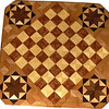 "Cbd Hb-Bub with Star 2<br />   This chessboard is 11 3/4"" square. Over all the board is 17 ¼"" square. Each square is just under 1 1/2"" and is made with 4 triangles.  Two types of wood are in the chessboard. six kinds of wood are on the whole board.  The dark square is ""Bubinga"" from West Africa; the light square is ""Hackberry"" from Missouri. ""Elm"" from Missouri is around the chessboard itself. The design in each corner is a variation of a ""Rolling Star"" quilt pattern. The wood on it, from the center of the star is ""Walnut"" and ""Maple"" from Missouri, ""Wenge"" from West Africa and then the ""Elm"". There are 560 pieces in the over lay, using 6 kinds of wood.<br /> <br /> Also on the back, I signed it, listed the wood, and dated it. After the date the words ""Foot Cut"" let you know I made it on my foot powered table saw. <br />   <br />    This gives a completely different look to a chessboard.  When not being used as a chessboard, it is made to hang on the wall from one corner.  They make a very beautiful wall hanging."