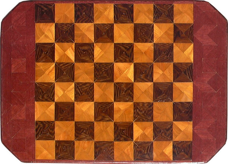 "Cbd 12X18 Wenge-Hedge-PH<br />  This chess board is 12"" square, 12 ½"" X 17 ½"" over all.  Each square is 1 ½"" and is made using 4 triangles.  Three kinds of wood are on the chess board.  The dark square is ""Wenge"" from West Africa; the light square is ""Hedge"" (Osage orange) from Missouri, ""Purple Heart"" from Central or South America is around the chessboard. There are 432 pieces in the over lay.<br /> <br />    On the back, I signed it, listed the wood, and dated it.  <br />   <br />   This gives a completely different look to a chess board.  When not being used as a chess board, it is made to hang on the wall.  They make a very beautiful wall hanging."