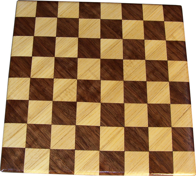 """Cbd Tiny Hb-Wal <br />    This chess board is 8 1/2"""" square. Each square is just over 1"""" and is made with 2 triangles back to back.  Two types of wood are in the chessboard. The dark square is """"Walnut"""" from Missouri; the light square is """"Hackberry"""" from Missouri.  There are 128 pieces in the over lay using two kinds of wood.<br /> <br />    Also on the back, I signed it, listed the wood, and dated it. After the date, the words """"Foot Cut"""" lets you know it was made on a foot powered table saw."""
